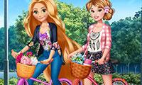 Habiller deux princesses pour faire du vélo